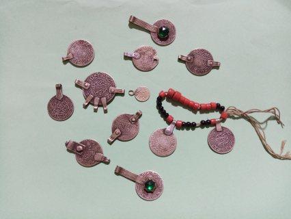 عقد مكون من 11 قطعة فضة ممتازة ترجع عام 1320