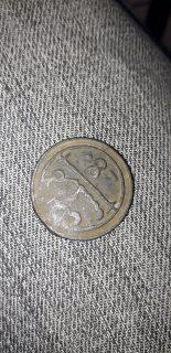 قطعة نقدية تعود لعصر المرينيين ذات النجمة السداسية و قطع اخرى
