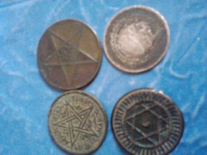 أربعة قطع نققدية قديمة